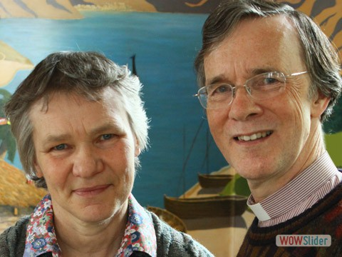 Our Vicar, Guy & his wife, Heather, in front of our magnetic art wall